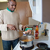 "Peter Ikewun, a petroleum engineeering graduate student from Nigeria, prepares a traditional African soup in his communal Wickersham Hall kitchen.  <div class=""ss-paypal-button"">Filename: LIF-12-3268-160.jpg</div><div class=""ss-paypal-button-end"" style=""""></div>"