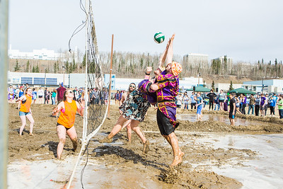 Students take part in the mud volleyball tournament during the 2016 SpringFest on the Fairbanks campus.  Filename: LIF-16-4879-308.jpg