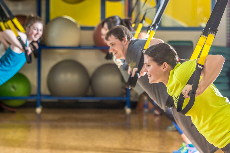 """Students work up a sweat during a fitness class on a Tuesday night in the Student Recreation Center.  <div class=""""ss-paypal-button"""">Filename: LIF-14-4111-17.jpg</div><div class=""""ss-paypal-button-end"""" style=""""""""></div>"""