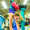 """Lindsey Dreese practices a move during a silk club meeting in the SRC. Dreese, a junior biology major, helped start the club which now features about 25 students and staff members who meet twice a week to learn new moves and increase strength and flexibility.  <div class=""""ss-paypal-button"""">Filename: LIF-13-4025-8.jpg</div><div class=""""ss-paypal-button-end""""></div>"""