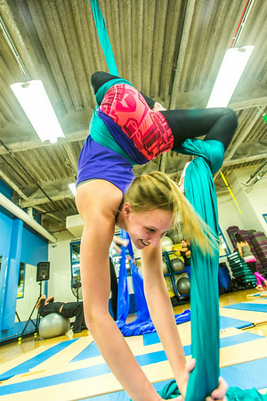 Lindsey Dreese practices a move during a silk club meeting in the SRC. Dreese, a junior biology major, helped start the club which now features about 25 students and staff members who meet twice a week to learn new moves and increase strength and flexibility.  Filename: LIF-13-4025-8.jpg