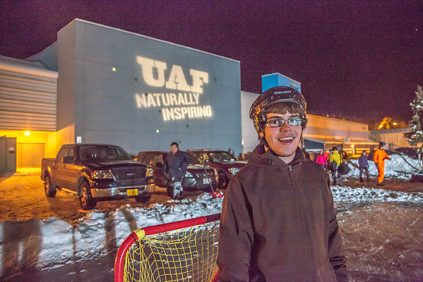 """Noah Betzen gets ready for a broomball match on the ice in front of the SRC on a cold November evening.  <div class=""""ss-paypal-button"""">Filename: LIF-12-3652-138.jpg</div><div class=""""ss-paypal-button-end"""" style=""""""""></div>"""