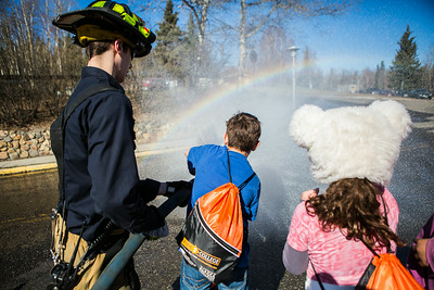 Youngsters try out firefighting equipment and gear during the Kids 2 College program on Campus.  Filename: LIF-14-4160-45.jpg