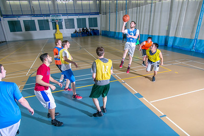 Intramural basketball action on a Tuesday night at the Student Recreation Center.  Filename: LIF-14-4111-326.jpg