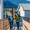 "Students Alyssa Wols, left, and Marjorie Tahbone walk between buildings at UAF's Northwest Campus in Nome.  <div class=""ss-paypal-button"">Filename: LIF-16-4865-205.jpg</div><div class=""ss-paypal-button-end""></div>"