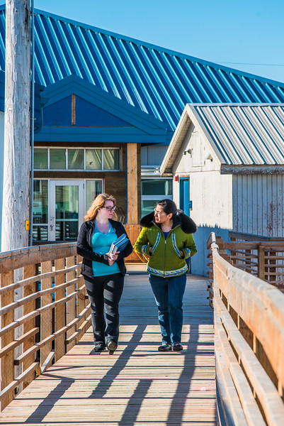 """Students Alyssa Wols, left, and Marjorie Tahbone walk between buildings at UAF's Northwest Campus in Nome.  <div class=""""ss-paypal-button"""">Filename: LIF-16-4865-205.jpg</div><div class=""""ss-paypal-button-end""""></div>"""