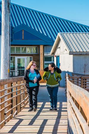 Students Alyssa Wols, left, and Marjorie Tahbone walk between buildings at UAF's Northwest Campus in Nome.  Filename: LIF-16-4865-205.jpg