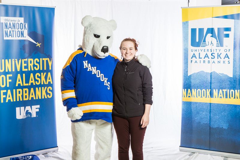 """Future UAF students and family members pose with the Nanook mascot during Inside Out.  <div class=""""ss-paypal-button"""">Filename: LIF-16-4839-64.jpg</div><div class=""""ss-paypal-button-end""""></div>"""