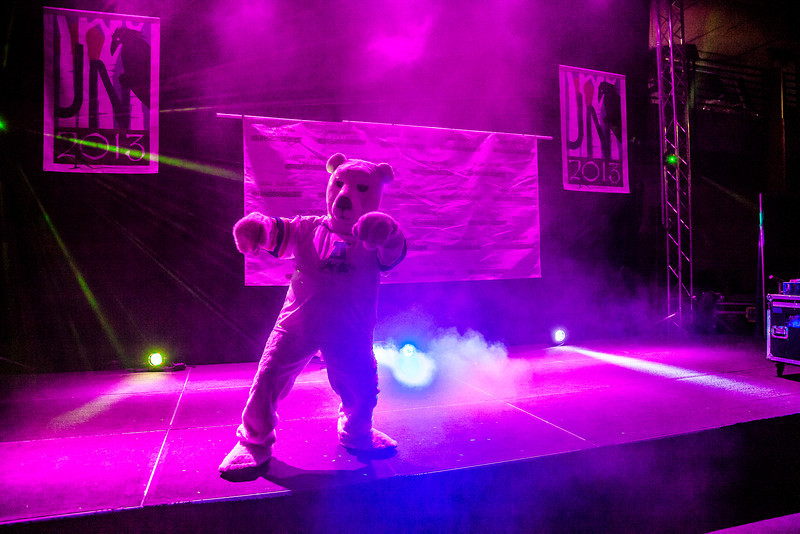 """The Nanook mascot strikes a pose on stage at the beginning of an after-dinner dance for athletes competing in the Junior Nationals Cross-Country Ski Championships March 16 in the SRC.  <div class=""""ss-paypal-button"""">Filename: LIF-13-3761-89.jpg</div><div class=""""ss-paypal-button-end"""" style=""""""""></div>"""