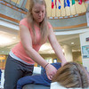 "Karley Scheuermann, a therapist with the Alaska Center for Natural Medicine, was on hand to offer free 15-minute massages to UAF employees during Staff Appreciation Day in the Wood Center.  <div class=""ss-paypal-button"">Filename: LIF-12-3413-18.jpg</div><div class=""ss-paypal-button-end"" style=""""></div>"