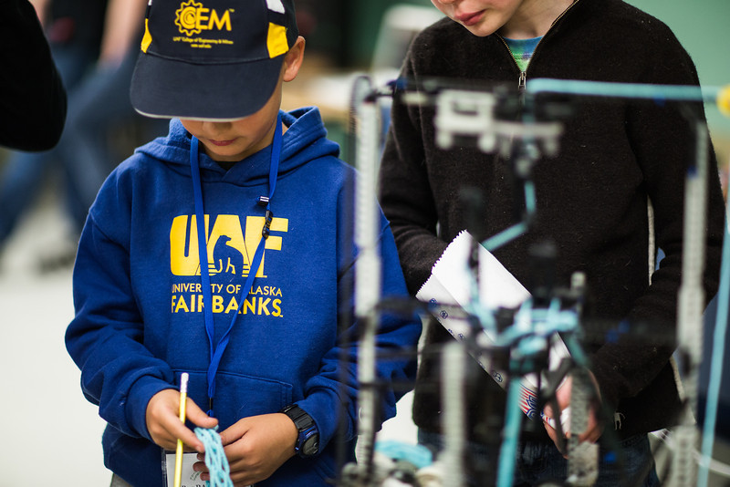 """""""Young engineers"""" study design robotics during the during the E-Week open house in the Duckering Building.  <div class=""""ss-paypal-button"""">Filename: LIF-13-3741-90.jpg</div><div class=""""ss-paypal-button-end"""" style=""""""""></div>"""