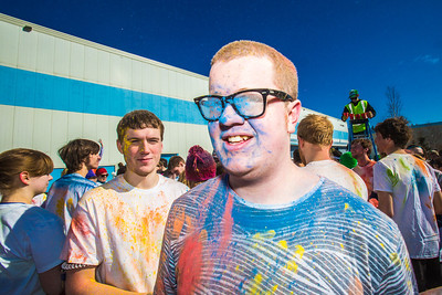 Students enjoy getting doused with colored dye before participating in a 5-kilometer run during SpringFest on the Fairbanks campus.  Filename: LIF-13-3805-54.jpg