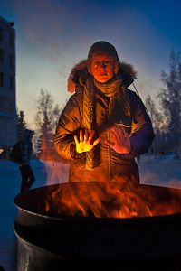With temperatures near 35 below zero, Celia Miller warms her hands by the fire during the Honors Program week-long vigil in Constitution Park to draw attention to the plight of the homeless.  Filename: LIF-11-3224-17.jpg