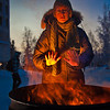 "With temperatures near 35 below zero, Celia Miller warms her hands by the fire during the Honors Program week-long vigil in Constitution Park to draw attention to the plight of the homeless.  <div class=""ss-paypal-button"">Filename: LIF-11-3224-17.jpg</div><div class=""ss-paypal-button-end"" style=""""></div>"