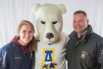 Parents and prospective students pose with 'Nook, the UAF mascot, during the Spring 2013 Inside Out event hosted by UAF's department of admissions.  Filename: LIF-13-3754-96.jpg