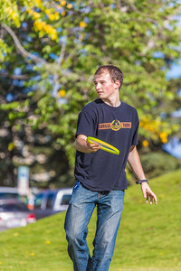 Engineering major Philip White takes time between classes to play with a frisbee on a beautiful September afternoon on the Fairbanks campus.  Filename: LIF-13-3934-45.jpg