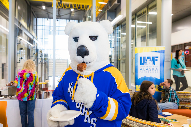 "Nook enjoys a tasty pastry during the 2018 Summer Inside Out's Donuts with Deans event.  <div class=""ss-paypal-button"">Filename: LIF-18-5826-116.jpg</div><div class=""ss-paypal-button-end""></div>"