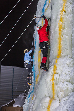 Climbers race to the top of the tower during the ice climbing competition, offered as part of the 2014 UAF Winter Carnival.  Filename: LIF-14-4084-90.jpg