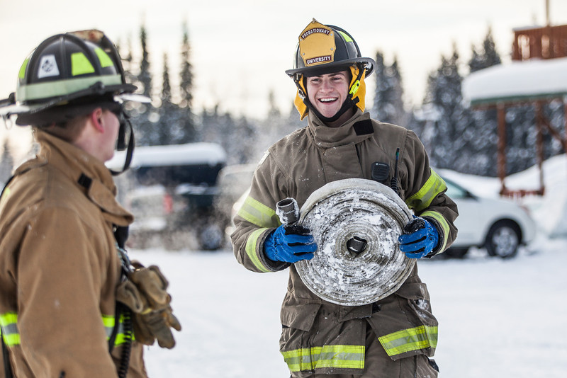 "Spencer McLean, left, and Aaron Stevens roll up a couple of fire hoses after filling an outdoor ice rink for children at Ice Alaska's George Horner Ice Park in Feb. 2013.  <div class=""ss-paypal-button"">Filename: LIF-12-3723-222.jpg</div><div class=""ss-paypal-button-end"" style=""""></div>"