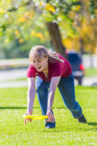 Music major Ingrid Dye takes time between classes to play with a frisbee on a beautiful September afternoon on the Fairbanks campus.  Filename: LIF-13-3934-22.jpg