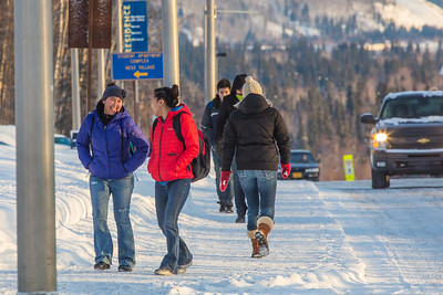 Students walk along Yukon Drive on the first day of classes in the spring 2013 semester.  Filename: LIF-13-3699-14.jpg