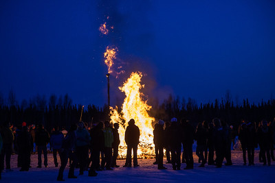 Participants from the 2013 USSA Junior National Cross Country Ski Championships gather around a bonfire after the awards ceremony at the Student Recreation Center March 16, 2013.  Filename: LIF-13-3760-38.jpg