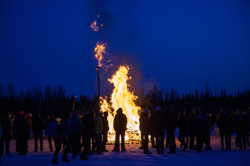 """Participants from the 2013 USSA Junior National Cross Country Ski Championships gather around a bonfire after the awards ceremony at the Student Recreation Center March 16, 2013.  <div class=""""ss-paypal-button"""">Filename: LIF-13-3760-38.jpg</div><div class=""""ss-paypal-button-end"""" style=""""""""></div>"""