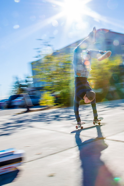 """Skateboarders hone their skills in front of the Rasmuson Library on a fine September afternoon.  <div class=""""ss-paypal-button"""">Filename: LIF-12-3540-25.jpg</div><div class=""""ss-paypal-button-end"""" style=""""""""></div>"""