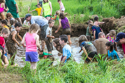 Kids and adult enjoyed getting down and dirty in the pit during Mud Day in the Georgeson Botanical Garden, sponsored by UAF's School of Natural Resources and Extension.  Filename: LIF-14-4212-02.jpg