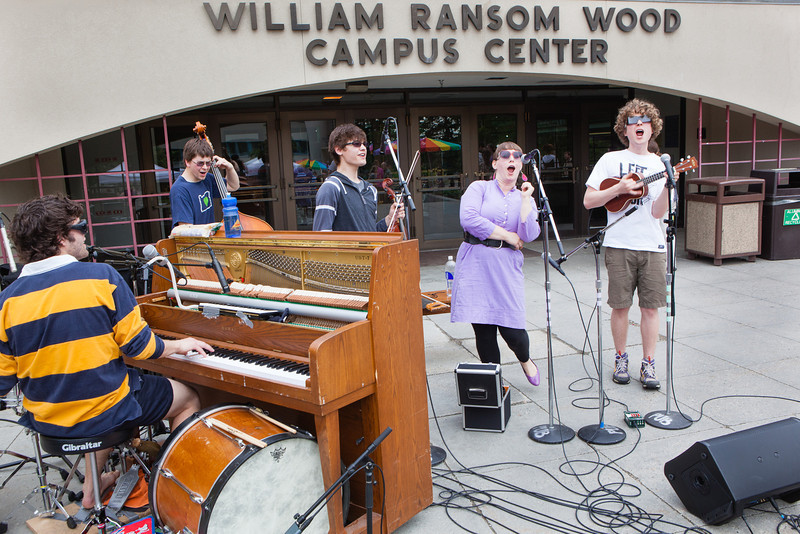 """Students, faculty, and community members buying ice cream from the Student Activities Office are entertained by local Fairbanks band, Haifa, in front of the Wood Center.  <div class=""""ss-paypal-button"""">Filename: LIF-12-3425-7.jpg</div><div class=""""ss-paypal-button-end"""" style=""""""""></div>"""