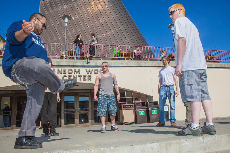 """A group of students play hacky sack outside the Wood Center on campus.  <div class=""""ss-paypal-button"""">Filename: LIF-12-3356-102.jpg</div><div class=""""ss-paypal-button-end"""" style=""""""""></div>"""