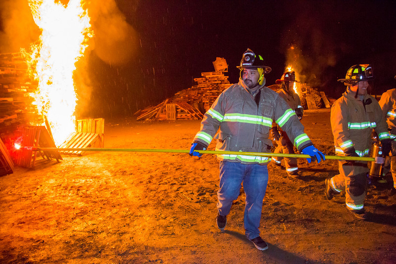 """Juan Cruz, chair of the student traditions board, was selected to help Chancellor Rogers light the traditional bonfires to start the 90th annual Starvation Gulch festivities Sept. 28.  <div class=""""ss-paypal-button"""">Filename: LIF-13-3955-77.jpg</div><div class=""""ss-paypal-button-end"""" style=""""""""></div>"""