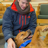 "Freshman biology major Ryan Weber takes advantage of some quality time with with a new friend on Dogs in the Library day. The event is offered during finals week to provide students with a bit of stress relief.  <div class=""ss-paypal-button"">Filename: LIF-13-4023-17.jpg</div><div class=""ss-paypal-button-end"" style=""""></div>"