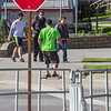 "A skateboarder rides the sidewalk down the hill past the Commons on a beautiful September afternoon on the Fairbanks campus.  <div class=""ss-paypal-button"">Filename: LIF-13-3934-1.jpg</div><div class=""ss-paypal-button-end"" style=""""></div>"