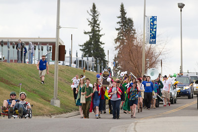 The Club Karneval Parade marched around campus from Reichardt building to the Nenana Parking Lot during the 2012 Spring Fest activities.  Filename: LIF-12-3384-118.jpg
