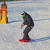 "Jimmy Donohue, surf-sledding, and his buddy Bryan Johnson spend some quality time on the UAF sledding hill on a nice February afternoon.  <div class=""ss-paypal-button"">Filename: LIF-12-3290-25.jpg</div><div class=""ss-paypal-button-end"" style=""""></div>"