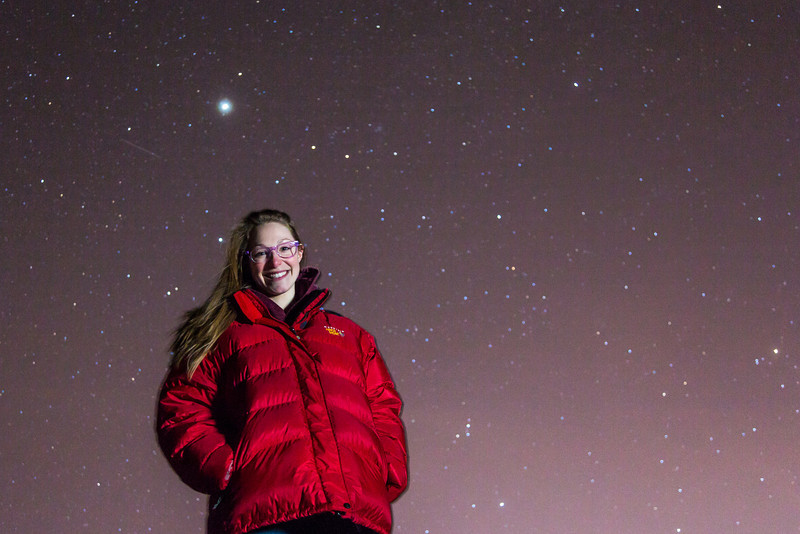 """Senior geology major Jessica Eicher stands under a starry sky on a mile February night near the Fairbanks campus. Eicher is one of 1,058 finalists from among more than 200,000 people who applied to join the Mars One mission. Mars One, a nonprofit based in The Netherlands, wants to begin sending groups of four individuals on one-way trips to the Red Planet starting in 2025. """"Once on Mars there are no means to return to Earth. Mars is home,"""" the group's website explains.  <div class=""""ss-paypal-button"""">Filename: LIF-14-4092-14.jpg</div><div class=""""ss-paypal-button-end"""" style=""""""""></div>"""
