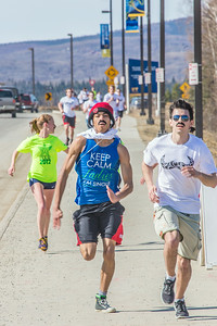 Participants in the Mustache Dash sprint for the finish line during SpringFest April 28.  Filename: LIF-14-4168-38.jpg