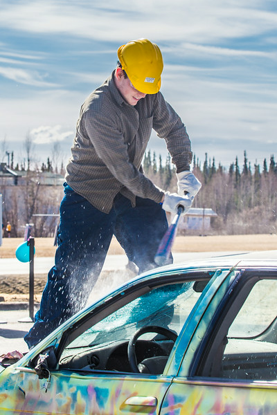 """For a fee, participants got to take a turn demolishing a donated car at a Moore Hall fundraiser during UAF's SpringFest Field Day April 28.  <div class=""""ss-paypal-button"""">Filename: LIF-14-4168-182.jpg</div><div class=""""ss-paypal-button-end""""></div>"""