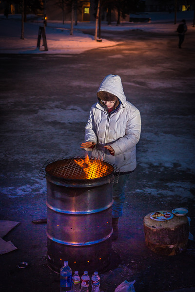 """Sarah Azrael takes her turn at the Honors Program homeless vigil Friday morning while the temperature hovered around -20°.  <div class=""""ss-paypal-button"""">Filename: LIF-12-3653-45.jpg</div><div class=""""ss-paypal-button-end"""" style=""""""""></div>"""