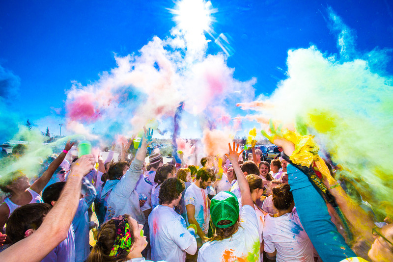 """Students enjoy getting doused with colored dye before participating in a 5-kilometer run during SpringFest on the Fairbanks campus.  <div class=""""ss-paypal-button"""">Filename: LIF-13-3805-62.jpg</div><div class=""""ss-paypal-button-end"""" style=""""""""></div>"""