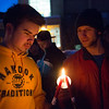 "Sage Tixier and Shaun Nesheim light candles with other students in commemoration of the 1957 Tradition Stone candlelight vigil on Constitution Park in March of 2013.  <div class=""ss-paypal-button"">Filename: LIF-13-3763-2.jpg</div><div class=""ss-paypal-button-end"" style=""""></div>"