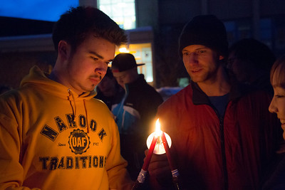 Sage Tixier and Shaun Nesheim light candles with other students in commemoration of the 1957 Tradition Stone candlelight vigil on Constitution Park in March of 2013.  Filename: LIF-13-3763-2.jpg