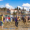 "A participant in the 2014 SpringFest mud volleyball bouts sets up a teammate.  <div class=""ss-paypal-button"">Filename: LIF-14-4167-78.jpg</div><div class=""ss-paypal-button-end""></div>"