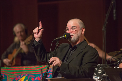 Host Larry Groce welcomes a packed house to one of two live recorded performances of the nationally broadcast radio show Mountain Stage in the Davis Concert Hall Aug. 17 and 18. The shows were sponsored by UAF Summer Sessions and KUAC-FM.  Filename: LIF-12-3502-041.jpg