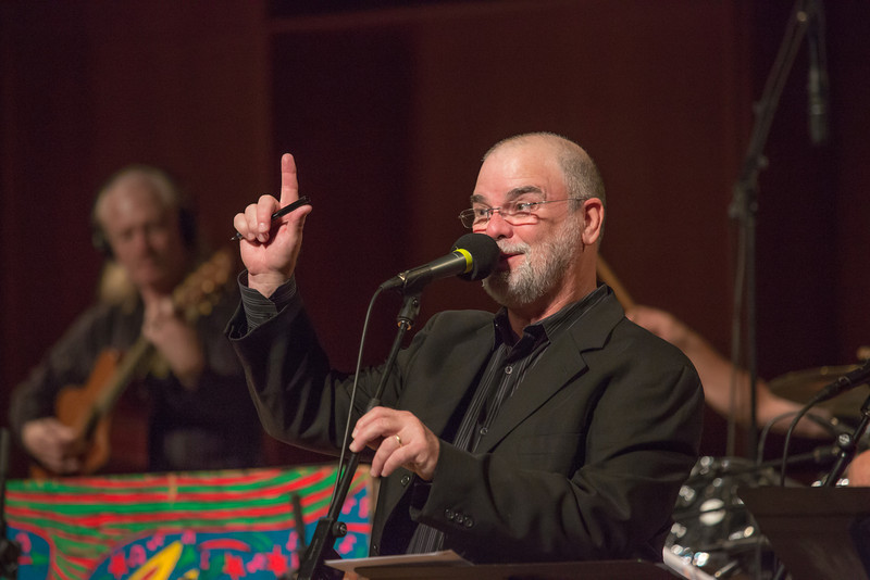 """Host Larry Groce welcomes a packed house to one of two live recorded performances of the nationally broadcast radio show Mountain Stage in the Davis Concert Hall Aug. 17 and 18. The shows were sponsored by UAF Summer Sessions and KUAC-FM.  <div class=""""ss-paypal-button"""">Filename: LIF-12-3502-041.jpg</div><div class=""""ss-paypal-button-end"""" style=""""""""></div>"""