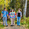 "Demetri Martin-Urban, left, Grace Amundsen, center, and Kaylie Wiltersen stroll through the woods near the west entrance to campus on a nice fall afternoon.  <div class=""ss-paypal-button"">Filename: LIF-12-3544-145.jpg</div><div class=""ss-paypal-button-end"" style=""""></div>"