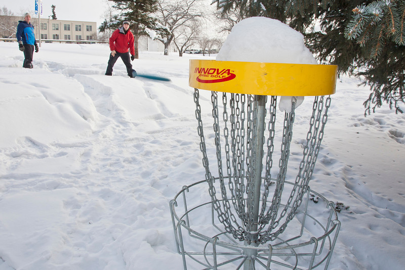 "Blaine DeWalt (right) and Sam Braband (left) play a game of  Frisbee golf in snowshoes as part of UAF's Winter Carnival.  <div class=""ss-paypal-button"">Filename: LIF-12-3303-02.jpg</div><div class=""ss-paypal-button-end"" style=""""></div>"