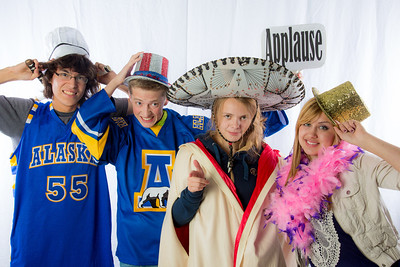 Students pose in the UAF Facebook photobooth during a back-to-school orientation party in the Wood Center.  Filename: LIF-12-3517-35.jpg