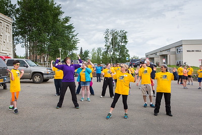 Participants in the 2016 Special Olympics Torch Run warm-up before starting the 5-kilometer run Saturday, May 21, 2016.  Filename: LIF-16-4908-5.jpg